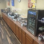 This is the breakfast area.  It has mini waffle maker, lots of fruit, and yogurt.  The coffee ma