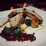 Rack of Lamb in peppercorn crust with red onions jam and spinach sauteed Canarian roasted potato
