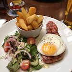 Ham Steak with Fried Egg, small salad, and thick cut chips