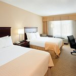 Spacious Guest Room with Two Queen Beds and Complimentary WiFi
