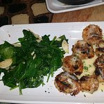 Scallops with sauteed garlic spinach