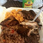 Jerk chicken (white) with mac and cheese and red beans and rice sides