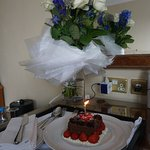 Flowers and cake delivered by staff for my birthday!
