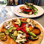 The pizza in the foreground tastes as amazing as it looks, and the salad behind was gorgeous too