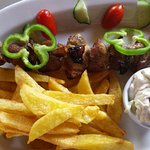 Chicken souvlaki with chips fried in extra virgin olive oil