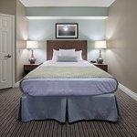 Queen size bed in a standard one bedroom efficiency