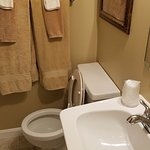 The toilet is tight to the wall. A seated performance requires the ability to ride side saddle.