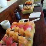 Foreground, Lady in Red, Pink Lady, Tuna and Salmon Nigiri.