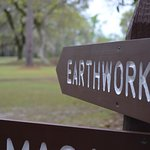 A sign directs visitors to the earthwork remains of the forts.