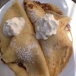 Pancakes with icecream and whipped cream.