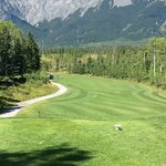 Dogleg left, mountains in the background