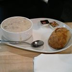 Thick clam chowder and homemade roll