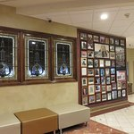 Stained glass windows and framed celebrities photos in the lobby