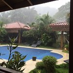 The pool between the villas during a rain storm.