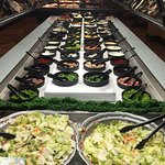 Salad bar and toppings.