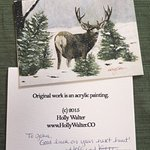Artist on staff signed card purchased in gift shop.