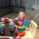 Photo of cups they give (and daughter being silly)