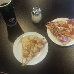 My first two plates of pizza and medium drink.