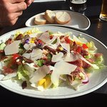 Delicious salad garnished with beautiful edible flowers.
