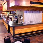 Our newest addition with recent renovations: a full bar with 12 taps of craft beer.