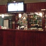 Full bar and two televisions.