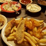 Sampler-2 piece catfish, 4 fried shrimp, 3 hush puppies & fries .   Also came with brown beans,
