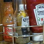 Table condiments at 84th Street restaurant needing to be filled.