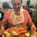 ROSARIO CASSATA ENJOYING SNOW CRAB LEGS AT THE CULL HOUSE IN SAYVILLE, NY