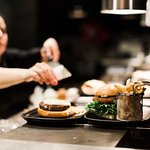 Proud chef plating burgers