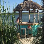 Lovely young lady at tiki hut #1 -- one of the best places to sit /relax on the island!