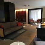 Hotel Lobby where a guest can make their own coffee (Keurig).