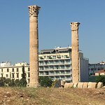 Hotel Athens Gate framed by two Corinthian columns at the Temple of Olympia Zeus.