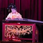 Lady playing a guhzeng prior to the show
