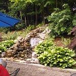 Patio has a waterfall.
