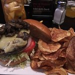 A beef burger with sauteed mushrooms and a side of their home-made potato chips - excellent!