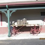 Old train baggage station cart in front of hotel