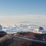 One of the Keck and the Subaru Observatories. Haleakalā in the background.