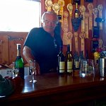 Owner Steve at the Tasting Bar; Note Awards in Background