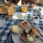Free breakfast -- first course, fruit and fresh biscuits and jam