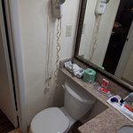 Hair dryer stopped & began to smoke, toilet actaully rocked because on the uneven floor .