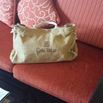 Casa Velas travel bag on couch