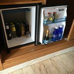 overpriced mini bar but doubles as a fridge!!