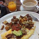 Chorizo & Avocado omelet, Fresh O.J., Coffee with Chocolate
