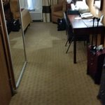 One narrow path into room #127 and no space to open suitcases