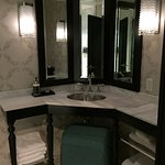 The vanity in the bathroom was attactive and functional