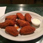 Wings are spicy and delicious!  The blue cheese is decent, not all runny and watery like you fin