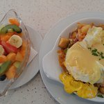 Eggs Benedict Scramble: 2 eggs, home fries, Bacon, Onions, pepper & cheese scramble & Fruit Cup
