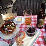 Greek salad, olives, bread and beer
