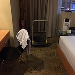 This was in the room when we checked in - A dirty shirt hanging and a cart / it was out of order