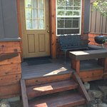 Entry, iron bench, small BBQ